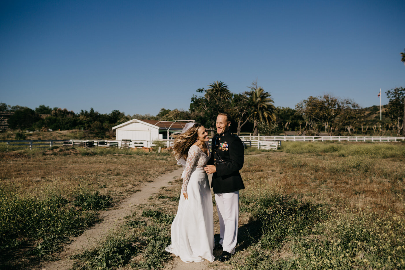 bride laughing in field
