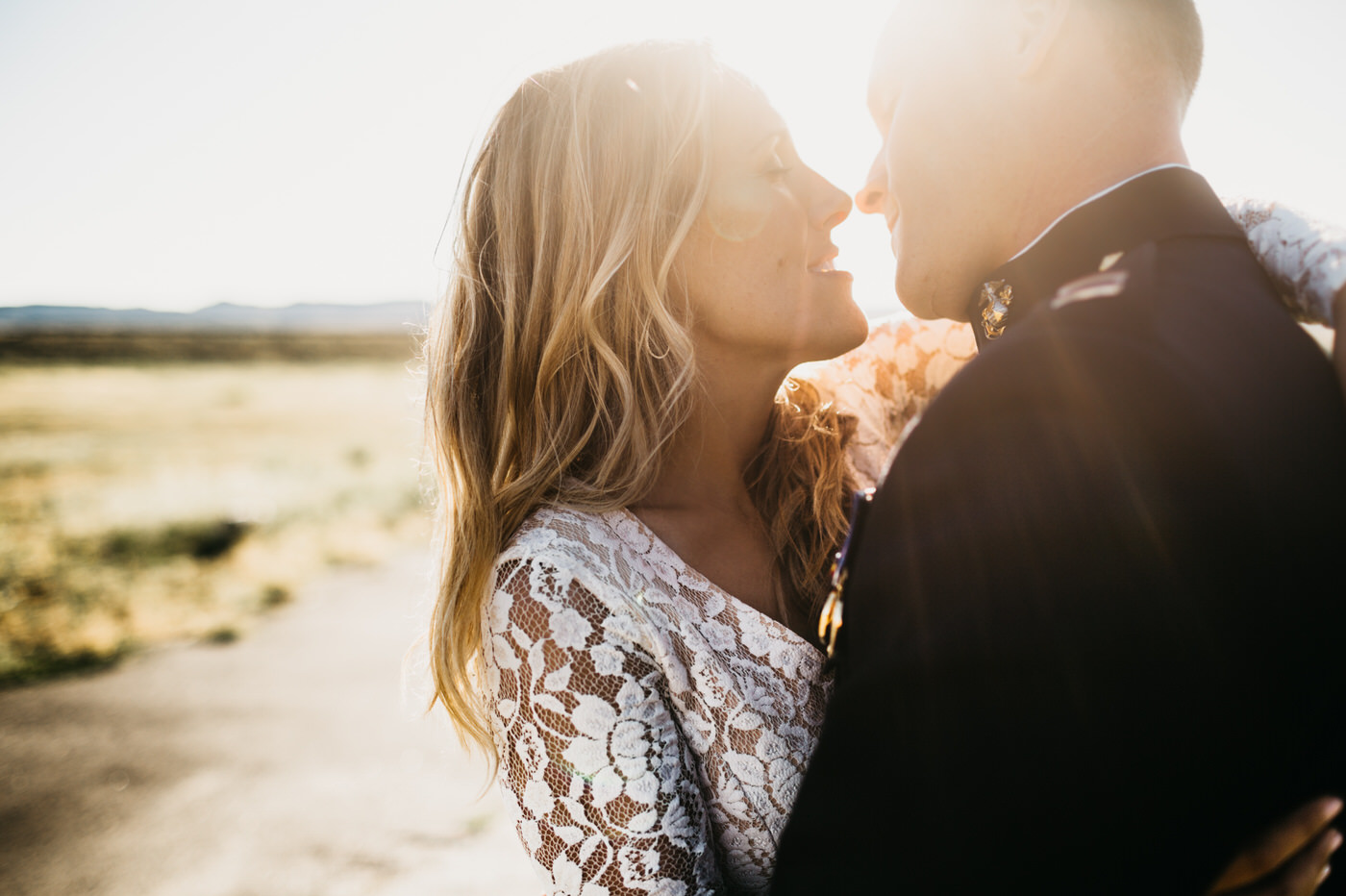 bride and groom in sun flare