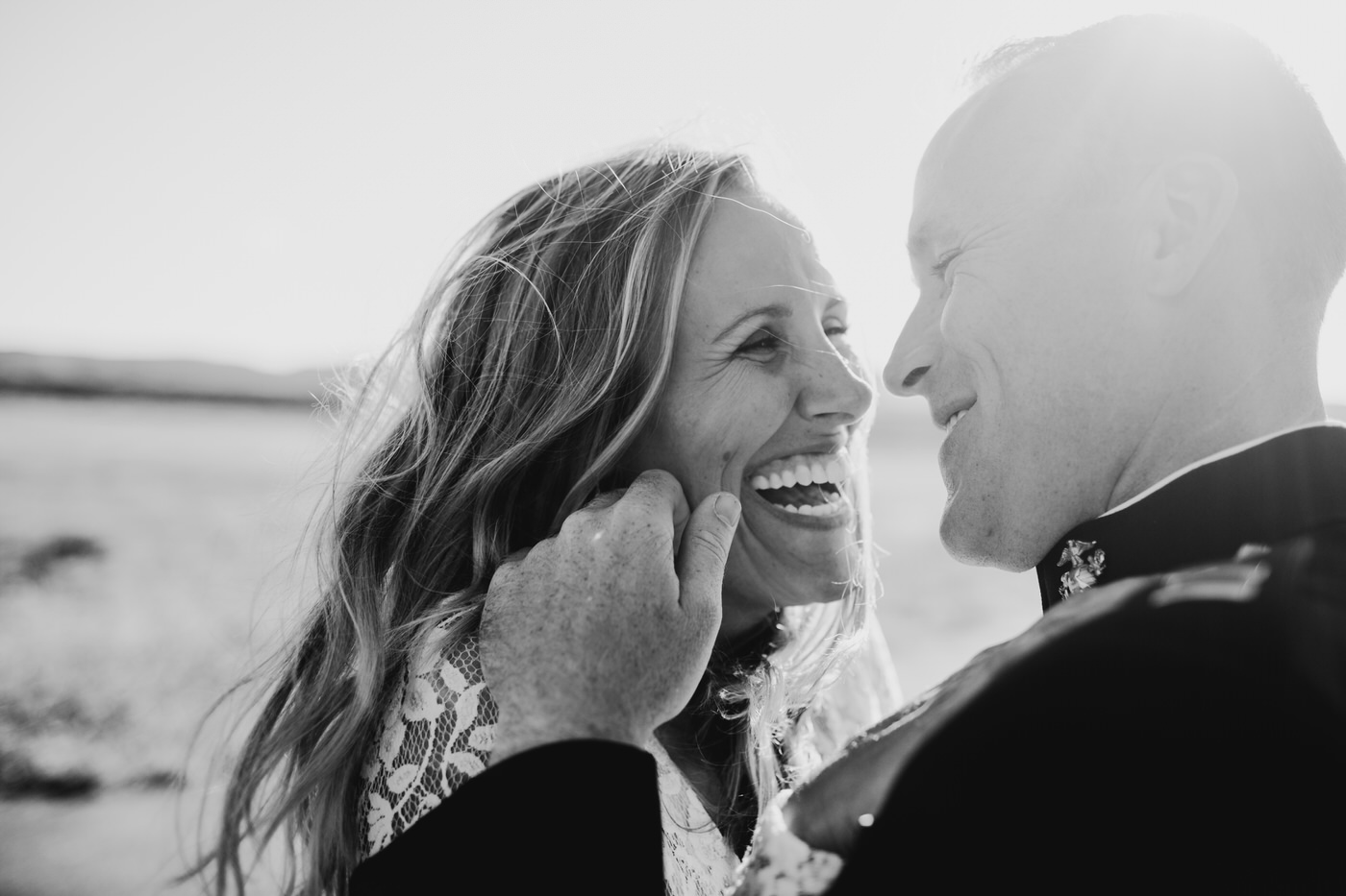 couple laughing black and white photo