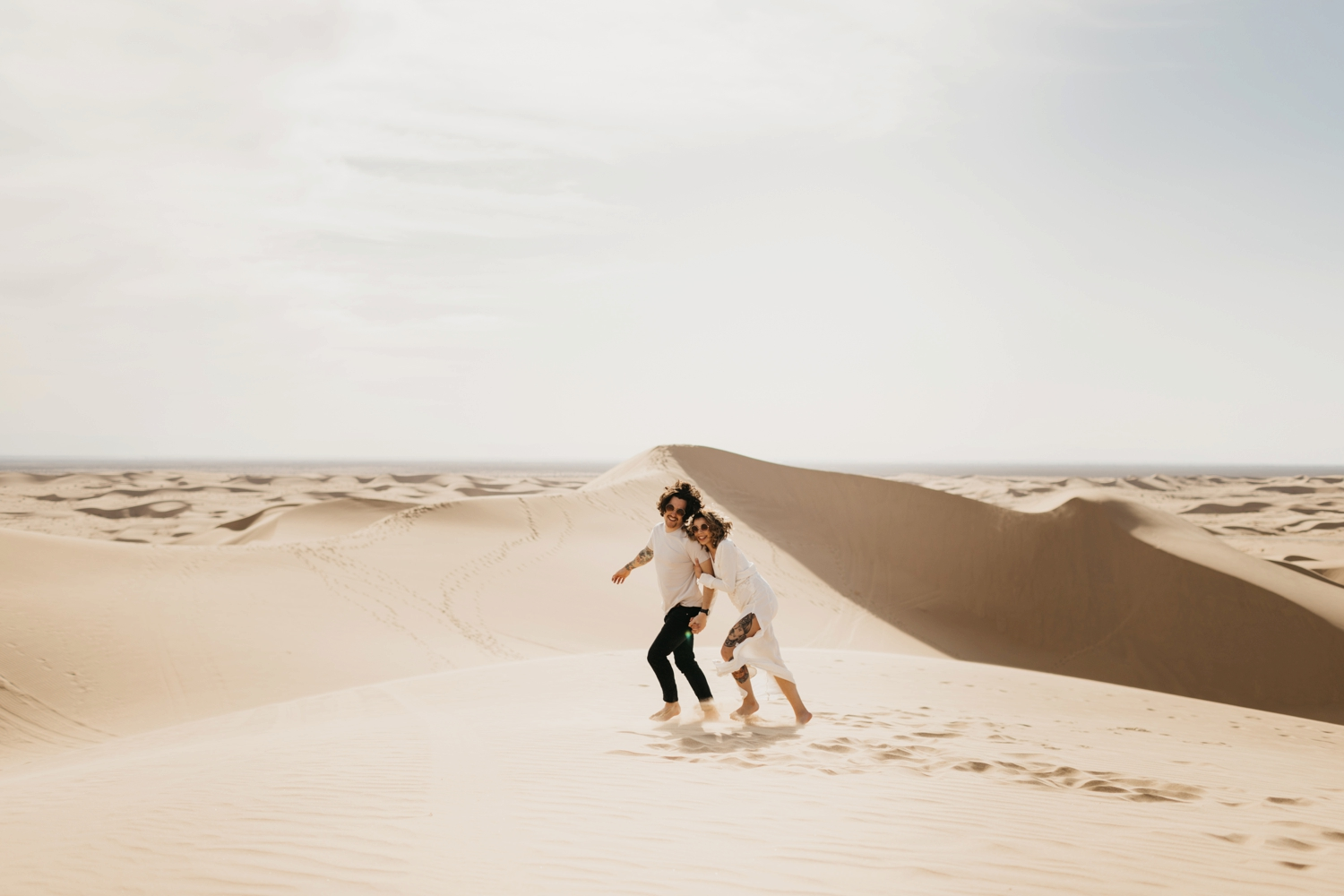 couple in sand dunes