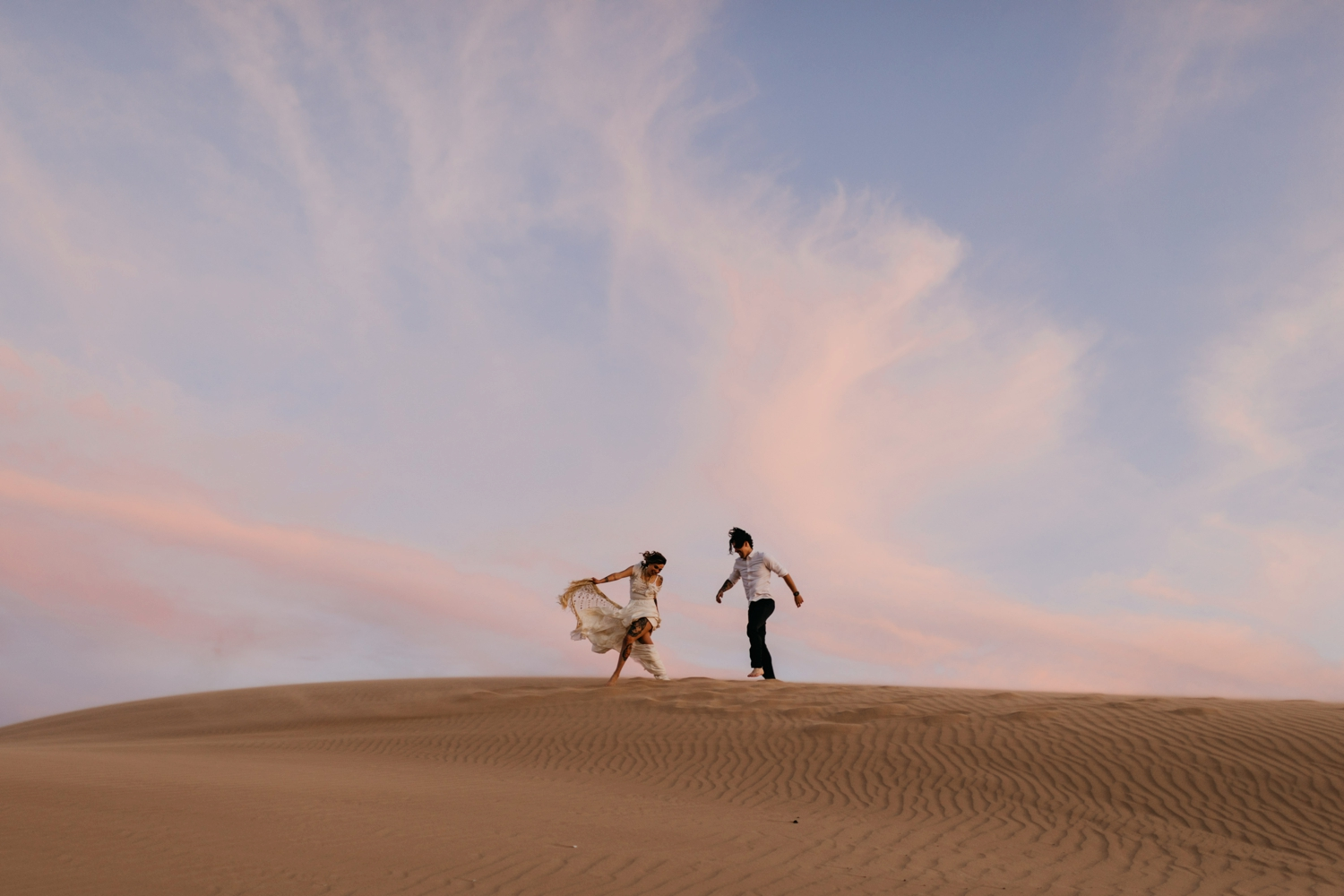 bride and groom in Morocco desert